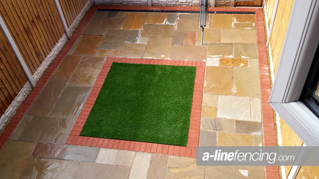 Fencing Indian stone paving, artificial grass, block border