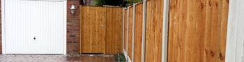 Garden fencing with timber gate