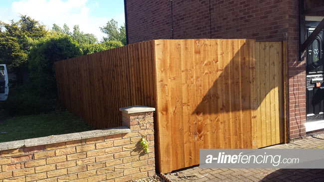 Garden fence with timber side gate